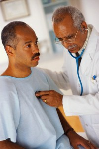 Listening to Patient's Heartbeat with Stethoscope
